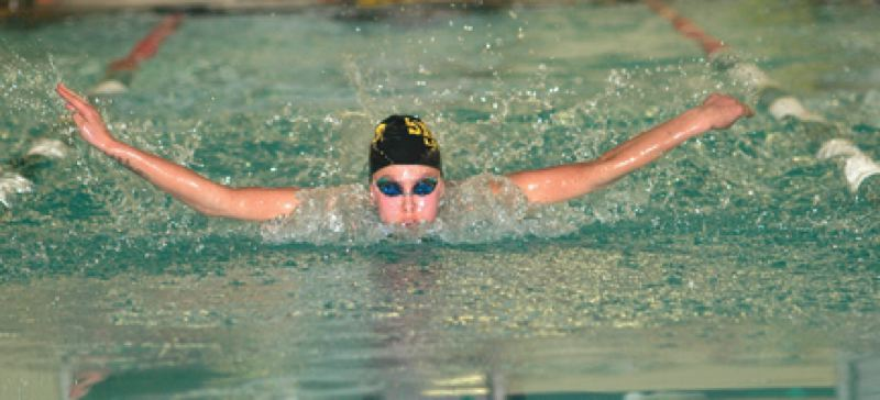 by: PARKER LEE - St. Helens' Brook Hopkins competes in the 200 individual medley during last Saturday's NWOC district swim finals. Hopkins was one of 10 Lions to qualify for the state swim meet this Friday and Saturday at Mt. Hood Community College.