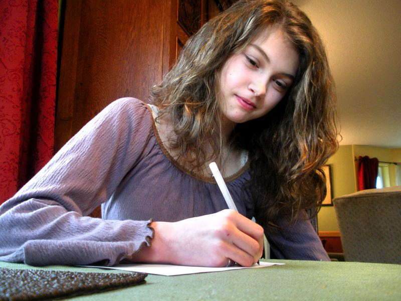 by: JIM HART - Hailey Richards, an eighth-grade student at Boring Middle School, is pictured putting pen to paper again as she did when she wrote an essay for the local VFW post's contest. Although Hailey's essay didn't win in the local contest, it was judged the best in Oregon in the recent statewide competition.
