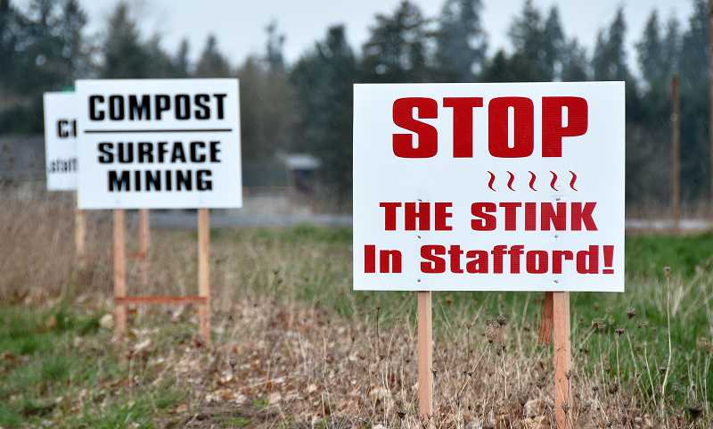 by: VERN UYETAKE - Residents against a proposed composting and land mining operation have posted signs throughout Stafford.