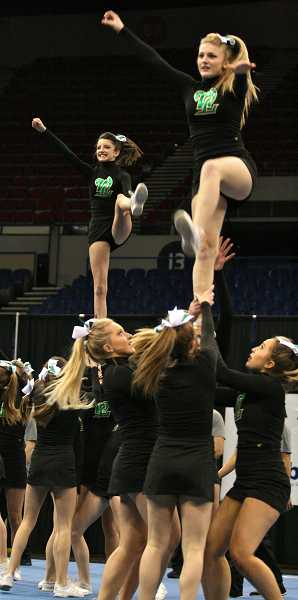 by:  J. BRIAN MONIHAN - Cheerleaders from West Linn High School competed in the state cheerleading championships last weekend. Flyers being lifted are sophomore Ashley Jones (front) and freshman Jori Monihan (back).