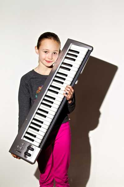 by: TIMES PHOTO: JAIME VALDEZ - Zoe Richter, a third-grader at Raleigh Hills K-8 School, is among the students looking forward to the Music Workshop program, which starts in six Beaverton schools on Feb. 15.