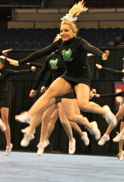 by:  J. BRIAN MONIHAN - Sophomore Sophia Eaton leaps into the air as part of a routine last weekend.