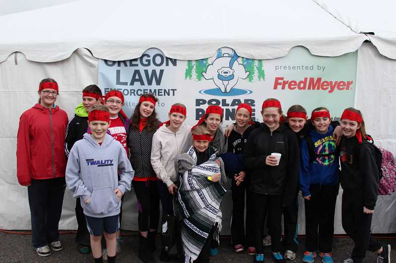 by: SUBMITTED PHOTO - Emily Johansen, third from right,and her Twality Middle School classmates raised thousands for Special Olympics Oregon during Saturday's Polar Plunge in Portland.