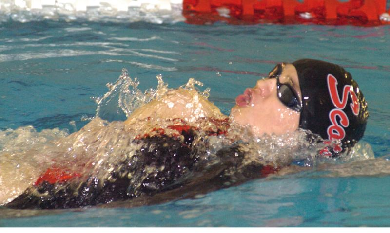 by: PAMPLIN MEDIA GROUP: DAVID BALL - Emma Nissen of David Douglas glides through the water during the backstroke Saturday. She won the 200 medley race earlier in the meet.