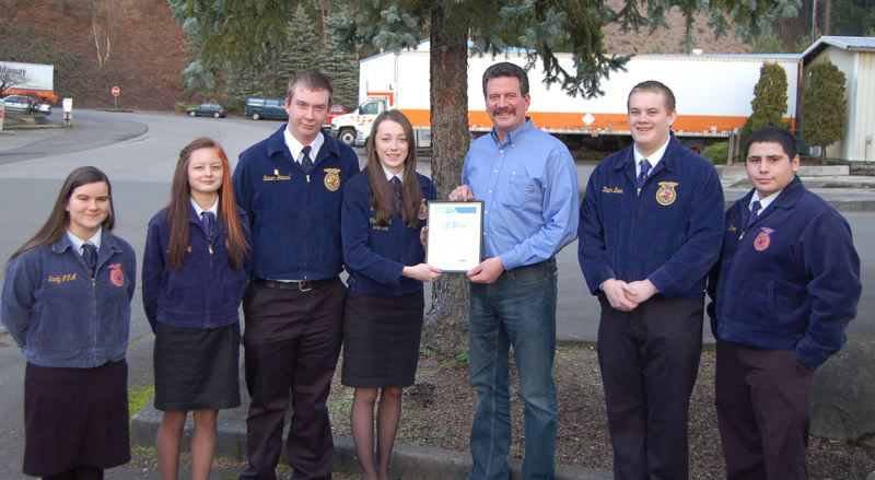 by: CONTRIBUTED PHOTO - After signing the proclamation that FFA Week in Sandy is Feb. 16-23, coinciding with National FFA Week, Sandy Mayor Bill King stood with Sandy High School FFA leaders to display the framed proclamation. Pictured, from left, are Secretary Faith Russell, Reporter Tommi Ezard, Vice-President Steven Grassl, President Sarah Rutledge, Mayor Bill King, Sentinel Dalton Davis and Treasurer Carlos Deker.