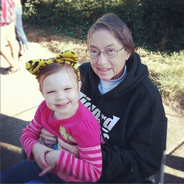 by: SUBMITTED PHOTO - Kittelson and granddaughter Molly Hughart attend the Tigard Homecoming Parade in October, 2012.