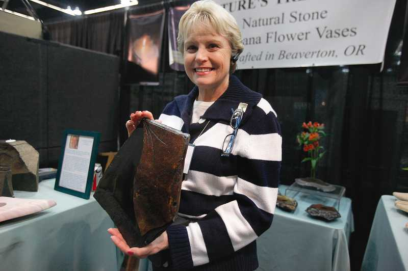 by: TIMES PHOTO: JONATHAN HOUSE  - Judy Kennedy of Natures Treasures in Beaverton shows off some of the stone work of her husband Don at the show. Don Kennedys sculptures and stonework have been featured across the country, including the Ansel Adams Gallery in Yosemite, Calif.