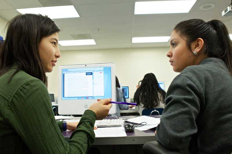 by: TIMES PHOTOS: JAIME VALDEZ  - Sunset High School seniors Amy Wang and Amy Morales, co-editors of The Scroll newspaper, go over stories for the paper's next online issue.