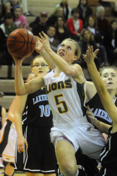 by: MATTHEW SHERMAN - West Linn's Ashley Johnson gets fouled on a drive to the basket in last week's win over Lakeridge.