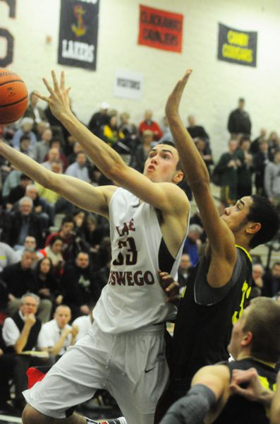 by: MATTHEW SHERMAN - Colin Caslick makes a drive to the hoop in Lake Oswego's win over No. 5 West Linn on Tuesday.