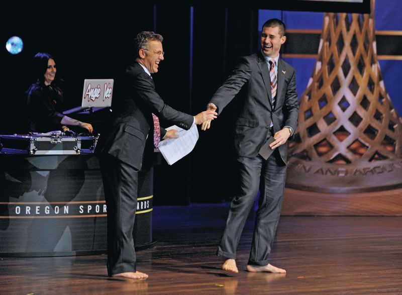 by: COURTESY OF JOHN LARIVIERE - ESPN's Neil Everett (left) and Fox Sports' Joey Harrington have fun with their matching footwear (or lack thereof) during the Oregon Sports Awards Sunday at Nike's Tiger Woods Center.