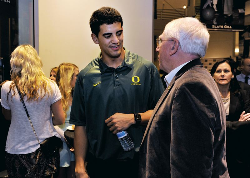by: COURTESY OF JOHN LARIVIERE - Oregon Ducks quarterback Marcus Mariota chats with UO public address announcer Don Essig at the Oregon Sports Awards.