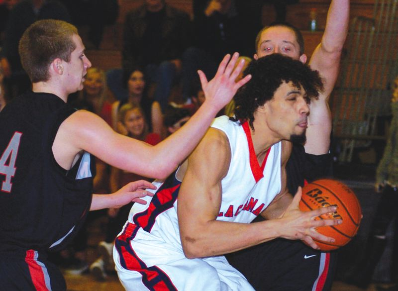 by: PAMPLIN MEDIA GROUP: DAVID BALL - Clackamas CC's Matt Bryant splits a pair of Mt. Hood defenders to get to the basket during the second half of Wednesday's 80-72 home win.