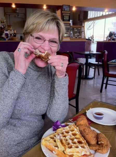 by: SUBMITTED PHOTO - WLACC member Peggy Dickston prepares to enjoy a Poshines Cafe de la Soul chicken & waffles breakfast.