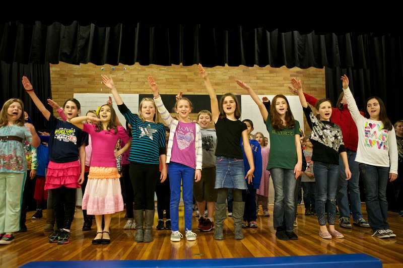 by: TIMES PHOTO: JAIME VALDEZ - Oaks Hills Elementary School students sing the preamble of the U.S. Constitution during rehearsal for the school's musical production of 'Schoolhouse Rock Live!' on Tuesday in the school's gymnasium.
