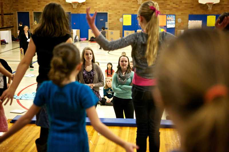 by: TIMES PHOTO: JAIME VALDEZ - Westview High School students Rachel Halversen and Emma Blattner help the students at Oak Hills Elementary School with their musical production of Schoolhouse Rock Live!