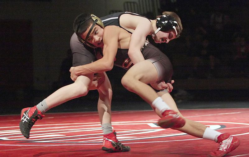 by: MILES VANCE - OPENING MATCH - Southridge's Caleb Johnen (right) tries to get after Westview's Kiel Resnick during his 8-3 win at 106 pounds. The Skyhawks won all but five of the day's weight classes to post a 47-29 win at Westview High School on Feb. 7.