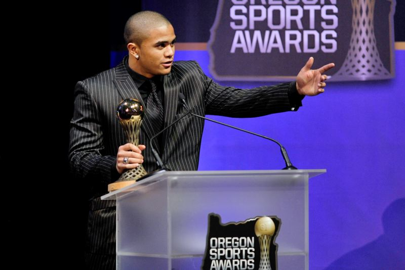 by: JOHN LARIVIERE - DOUBLE WINNER - Aloha's Thomas Tyner accepts one of the two awards he won at Sunday's Oregon Sports Awards.