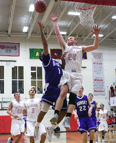 by: MILES VANCE - WILDCAT - Westview junior forward Trent Glasgow gets airborne to challenge a shot by Sunset's Joe McFerrin III during the Wildcats' 58-52 Metro League win over the Apollos at Westview High School on Friday night.
