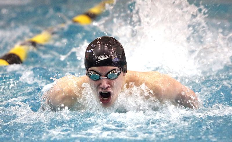 by: MILES VANCE - TO THE MAX - Southridge's Max Yakubovich makes waves while winning the 100-yard butterfly race at Saturday's Metro League District Meet at Tualatin Hills Aquatic Center.