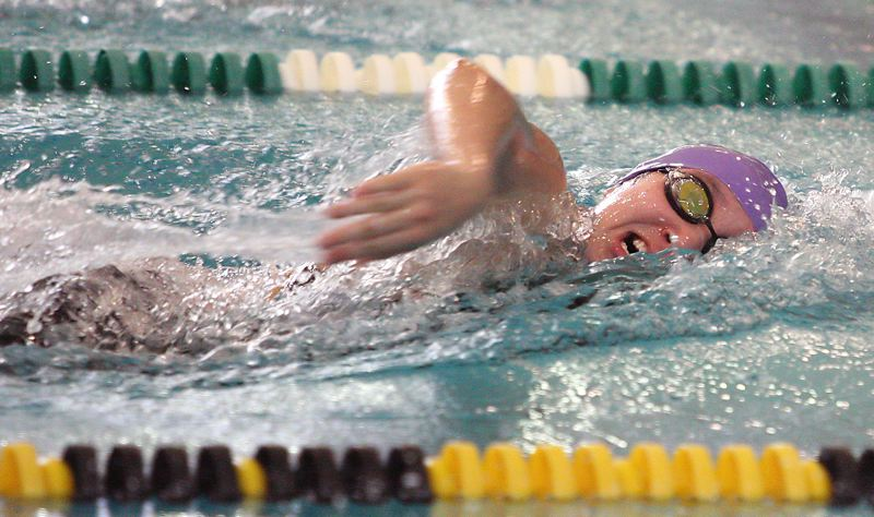 by: MILES VANCE - SUPER SOPHOMORE - Sunset sophomore Emily Cheng races to victory in the 200-yard freestyle at Saturday's Metro District Meet.