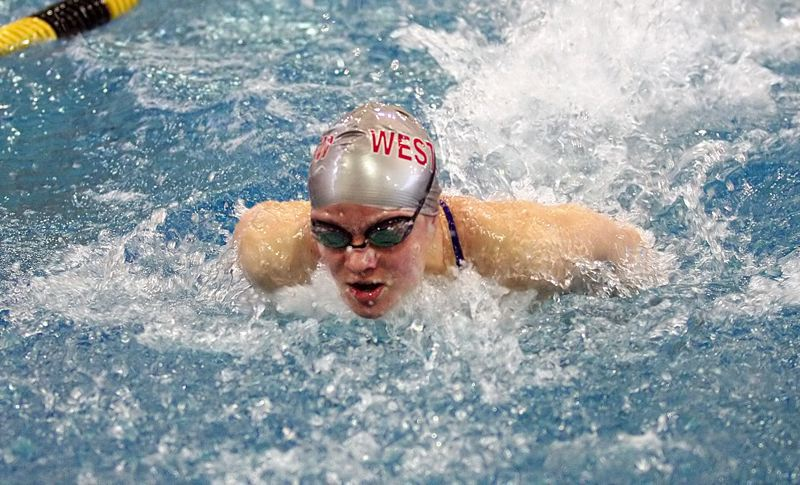 by: MILES VANCE - TO VICTORY - Westview senior Michelle Cefal churns to a win in the 100-yard butterfly, and later won the 100 backstroke at district.