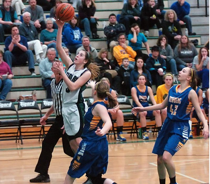 by: DAN BROOD - FAST BREAK -- Tigard junior Emilee Cincotta goes up to the basket after getting a steal in the Tigers' win over Newberg.
