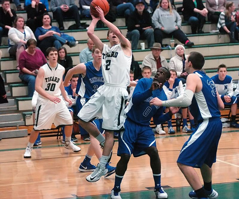 by: DAN BROOD - SLICK NICK -- Tigard High School senior Nick Kaelin (2) goes up to the basket during the first quarter of the Tigers' game with Newberg. Kaelin had 11 points and six rebounds in the 69-46 victory.