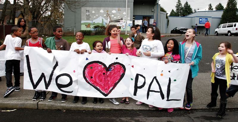 by: OUTLOOK PHOTO: JIM CLARK - Children who attend the PAL center in Rockwood after school protested Feb. 13, a day after officials announced the center will close at the end of the week.