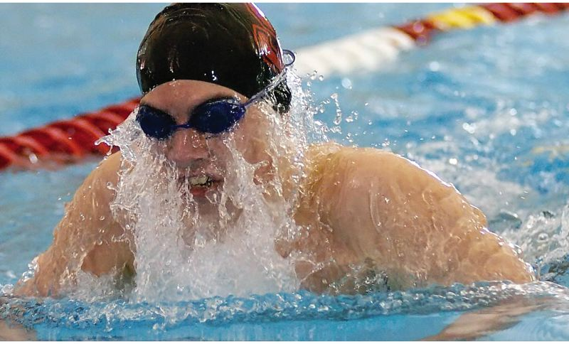 by: THE POST: DAN BROOD - Sandys Nick Chaney breaks through the water during his fifth-place effort in the breaststroke during Saturdays 5A swim finals.
