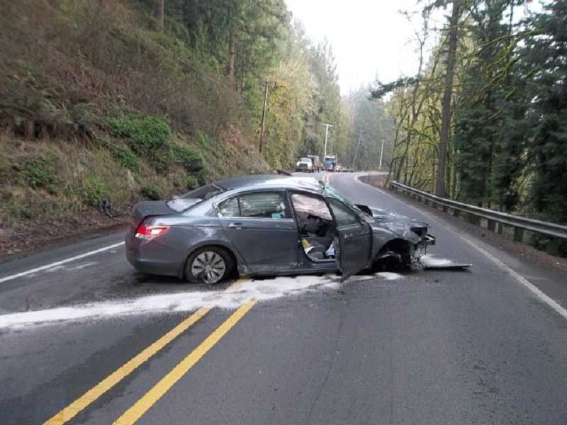 by: OREGON STATE POLICE - Kimberly Ross of Tigard was driving along  Highway 224 on Monday when she somehow drove off the road, up an embankment, rolled her vehicle and landed across the highway, Oregon State Police said.