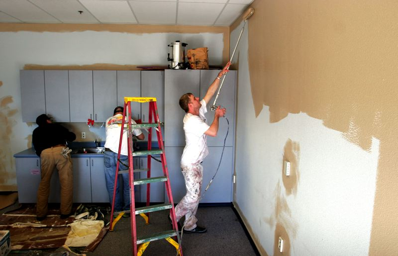 by: OUTLOOK PHOTO: JIM CLARK - Volunteers paint the interior of the Department of Human Services building on Friday, Feb. 15.