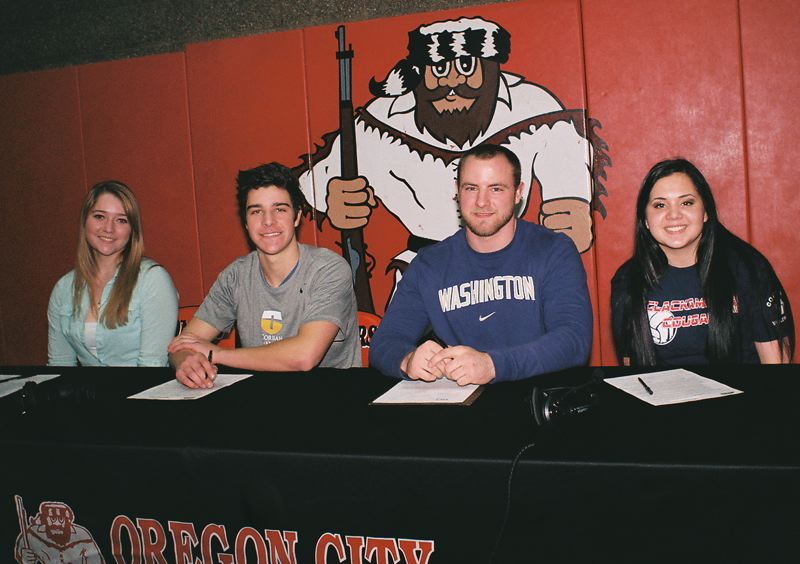 by: JOHN DENNY - (LEFT TO RIGHT) Stefanie Snow, Rilyn Lewchuk, Beau Brosseau and Sierra VeraCruz signed letters of intent to compete in college athletics during Feb. 6 letter of intent signing ceremonies at Oregon City High School.