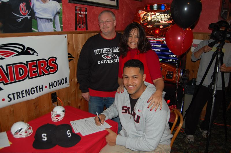by: ANGELA FOX - Proud parents Sherry and Brian Vance were on hand on Feb. 6 when their son Jon Kenion accepted a full-ride scholarship to play football at Southern Oregon University.