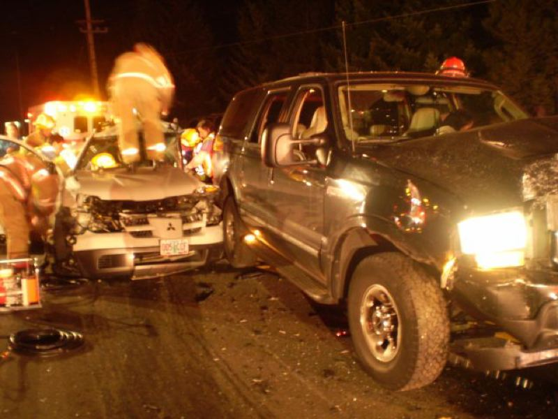 by: PHOTO COURTESY: OREGON STATE POLICE - SUVs lie mangled at the side of Highway 213 while Clackamas Fire crews extricate a seriously injured Oregon City girl.