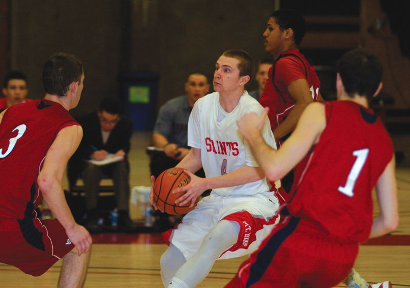 by: THE OUTLOOK: DAVID BALL - Mt. Hood CC guard Landon Rushton drives through a crowd of SW Oregon defenders during the second half of Saturdays 76-67 loss to the Lakers.