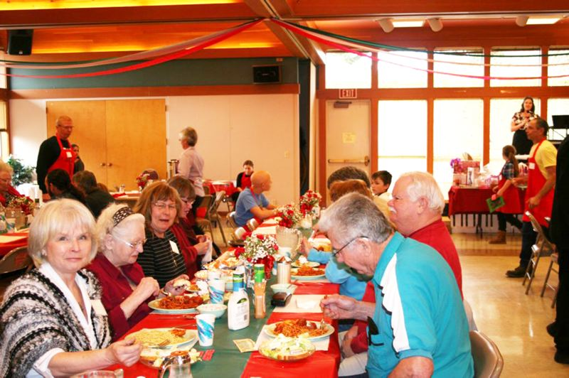 by: COURTESY PHOTO - Diners enjoy all-you-can-eat spaghetti and meatballs, as well as salad, bread, wine and other beverages, at the St. Anthonys fundraising dinner last year. Organizers expect more than 1,000 customers this Saturday.
