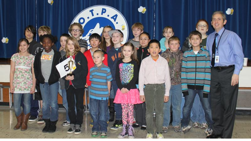 by: CONTRIBUTED PHOTO: CHIKAKO HOKANSON - Participants in the third annual spelling bee at the Oregon Trail Primary Academy show their pride in a job well done. From left, back row: Skyler Corpuz, Zeke Morrison, Dillon Leavelle, Victoria Yates, Daniel Hardin, Chloe Kulla and Devon Waldron. Middle row: Peyton Lekberg, Nicholas Chan, Landon Sheckard, Jenna Grimmer, Justin Zigler, Andrew Hokanson and James Milliken (principal). Front row: Phoenix Gan, Lousara Gatchell, Soren Ofstie, Keenan Bayer, Ella Andersen and Jerry Shen. Not pictured, but among the spelling bee finalists, are Catherine Nishida, Eli Atkinson, Elena Cabrera and Isabelle Cabrera. CONTRIBUTED PHOTO: CHIKAKO HOKANSON
