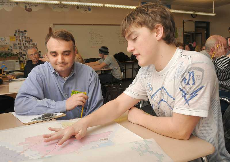 by: VERN UYETAKE  - Garrett Watson makes his group presentation to West Linn City Councilor Thomas Frank.