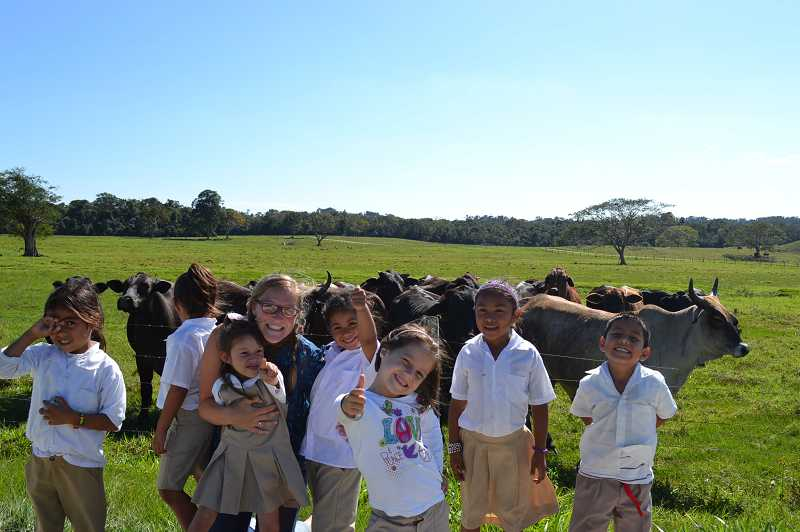 by: CAELEN BENSEN - Children and animal life blend in harmony in Belize.