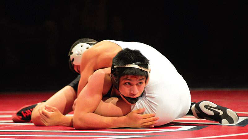 by: NEWS-TIMES PHOTO: CHASE ALLGOOD - Forest Grove senior Ivan Mojica wrestles Hillsboro's Joe Rodriguez for a 120-pound championship at the Special District 1 regional tournament.