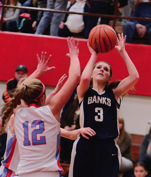 by: NEWS-TIMES PHOTO: CHASE ALLGOOD - Banks junior Lauren Birr gets off a jump shot over the Seaside defense during last Tuesday's game.