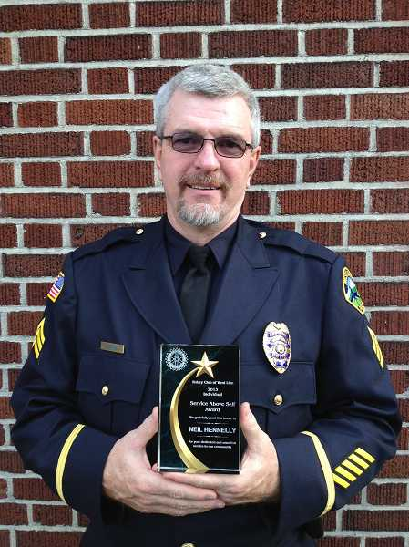 by: SUBMITTED - Sgt. Neil Hennelly is the 2013 recipient of the West Linn Rotary's Service Above Self award through Rotary International. Hennelly has been with the West Linn Police Department for 23 years.