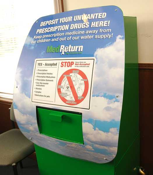 by: VERN UYETAKE - The drug drop box located in the lobby of the West Linn Police Department accepts both over-the-counter and prescription drugs.