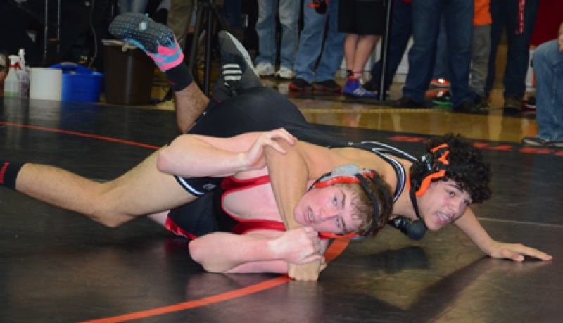 by: JOHN BREWINGTON - Scappoose's Isaiah Goodrich (top) made up for a third-place showing at district by winning the more important regional title. He beat William Prince of Tillamook 6-1 in this bout and went on to avenge an earlier loss to Myron Moore of Tillamook, 1-0.