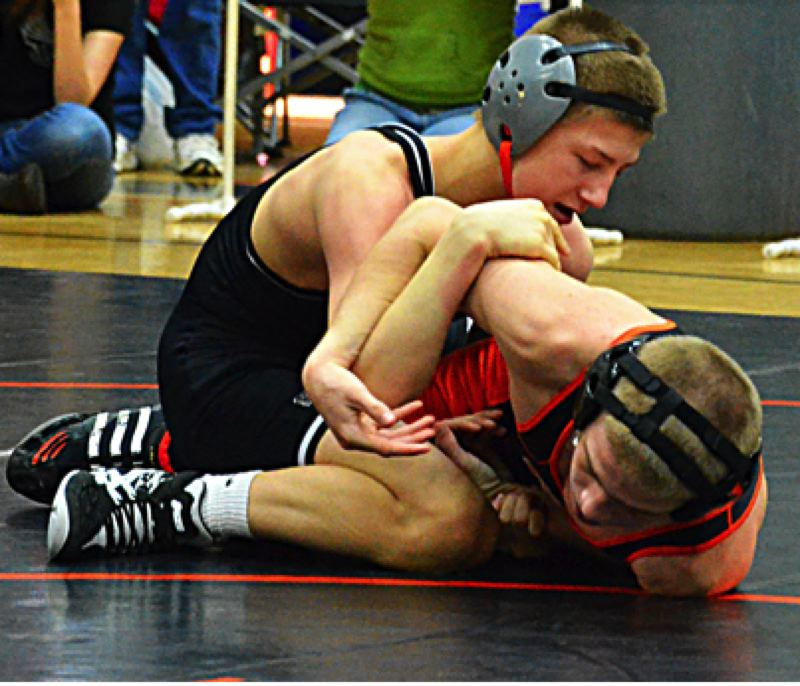 by: JOHN BREWINGTON - The Tribe's Kurt Mode won this semifinal match against Michael Alger of Gladstone. He went on to post an upset win over Collin Purington of Banks in the finals, a wrestler he had never beaten in several tries.