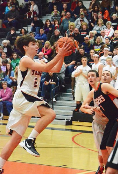 by: JOHN BREWINGTON - Scappoose's Chris Tinning scored in double figures against YC on Tuesday. Friday he left Astoria's game for the hospital after a blow gave him a concussion.