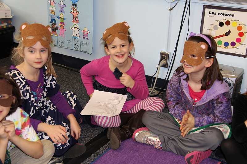by: SUBMITTED PHOTO: KIRSTEN AND MARK CARNESE -  Emerson Smith, Emma Carnese and Munroe Blem participate in 'Los Tres Osos' Reader's Theater performance in the first grade Spanish Immersion classroom at Lake Grove Elementary School.