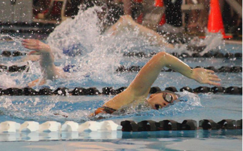 by: KEVIN ALVAREZ FOR THE SPOTLIGHT - Scappoose's Sadie Krahn competes in the 100 free prelims at the state meet last weekend.
