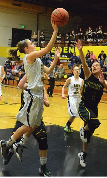 by: JOHN BREWINGTON - St. Helens' Rianne Tupper takes a shot during Friday's game with Rex Putnam.